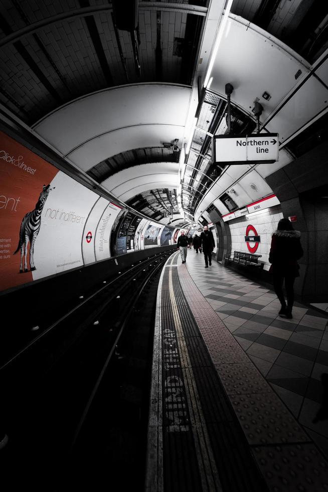 London, England 2018-Traveller's walk through an underground subway photo