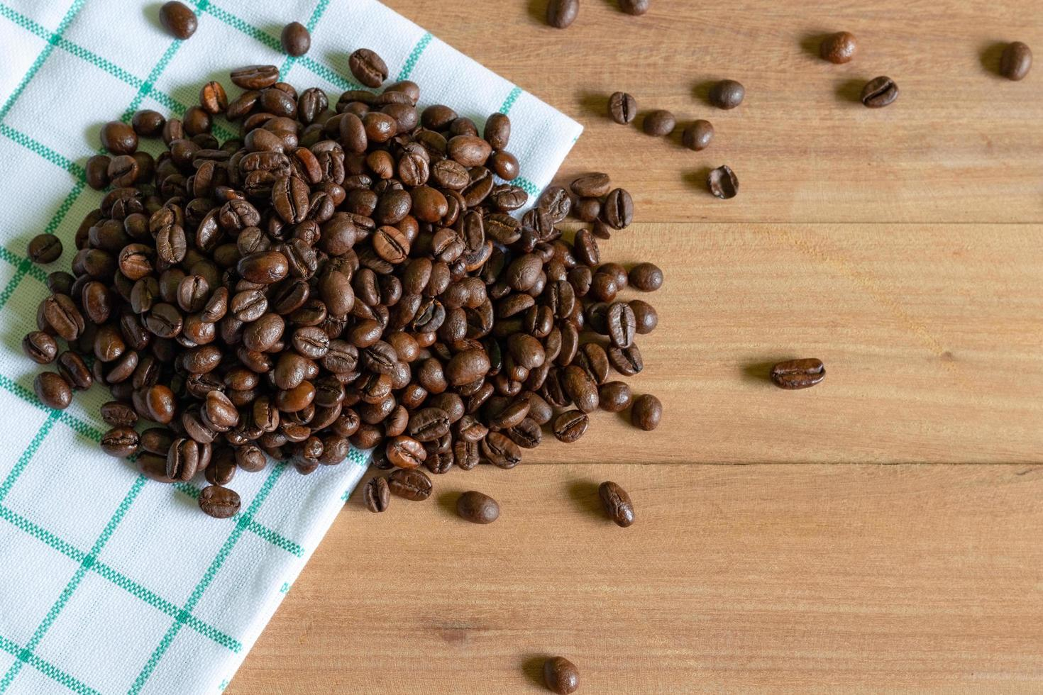 Roasted coffee beans on wooden background photo