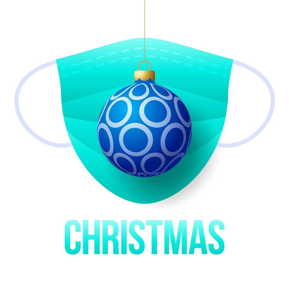 bola de navidad azul realista con mascarilla médica desechable vector
