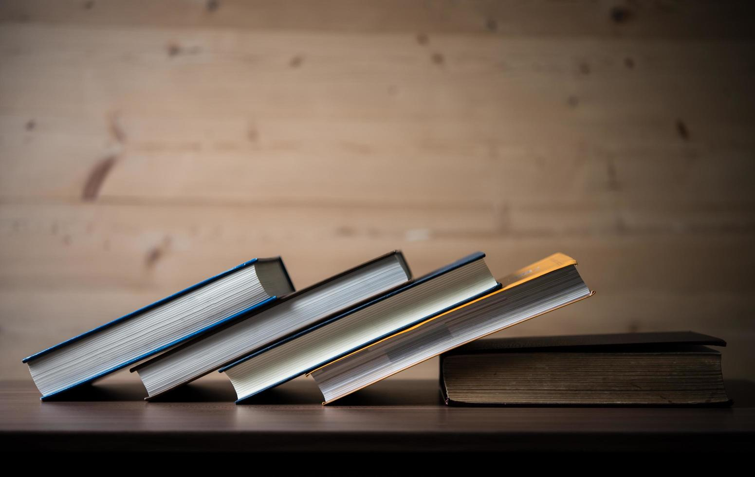 Stack of books on wooden table photo