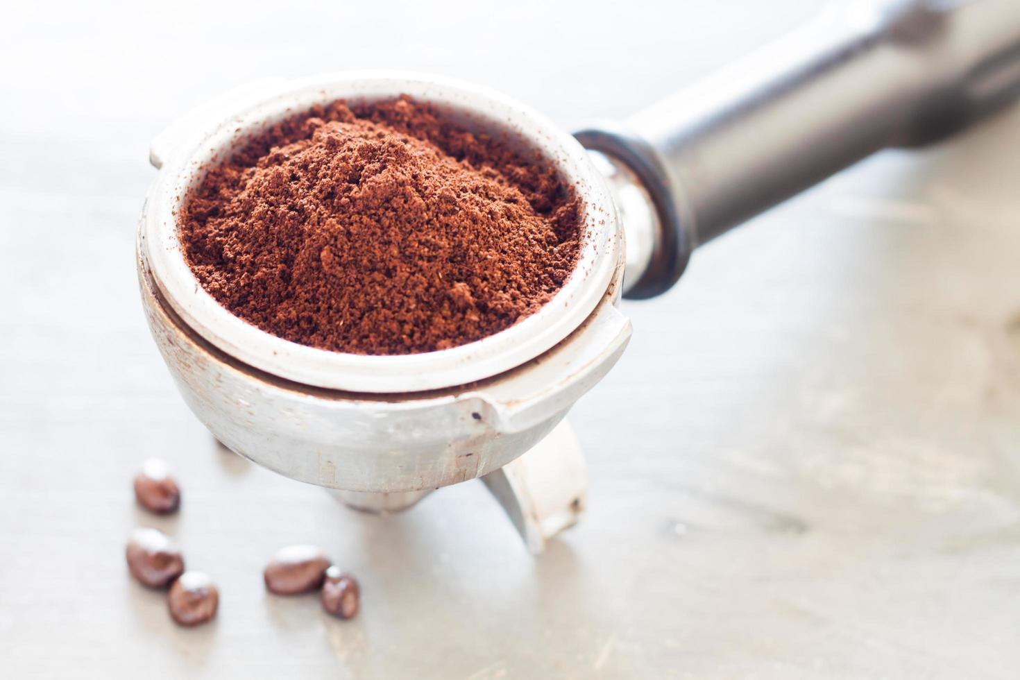 Coffee grinder with coffee in it photo