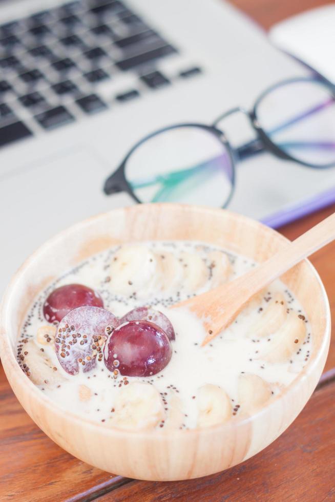 Bowl of oatmeal on a desk photo