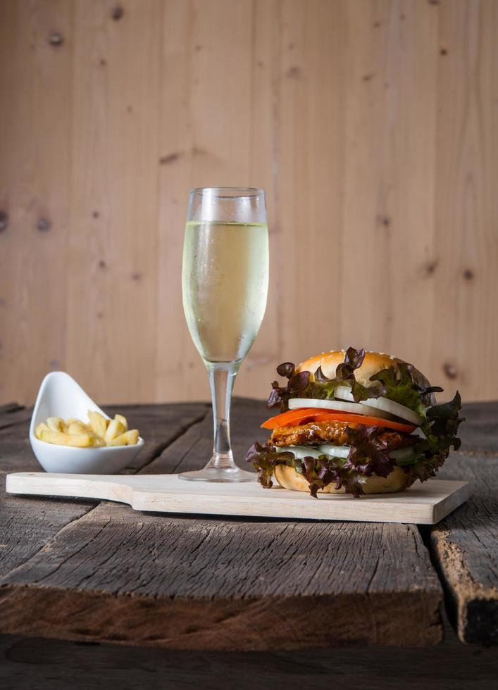 Homemade chicken burger with champagne and french fries photo