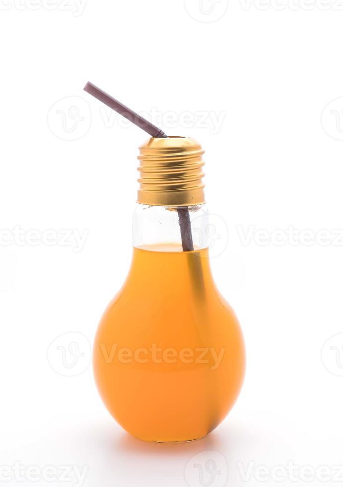 Orange juice in a lamp shape glass photo