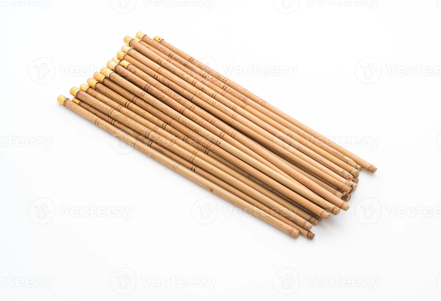 Bamboo chopsticks on white background photo