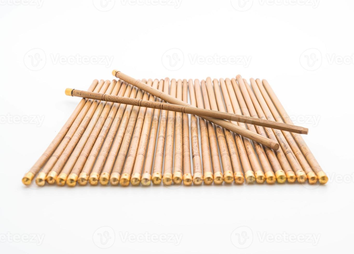 Bamboo chopsticks on white background photo