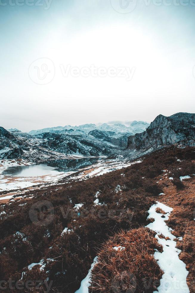 Vertical panoramic view of a mountain range during winter photo