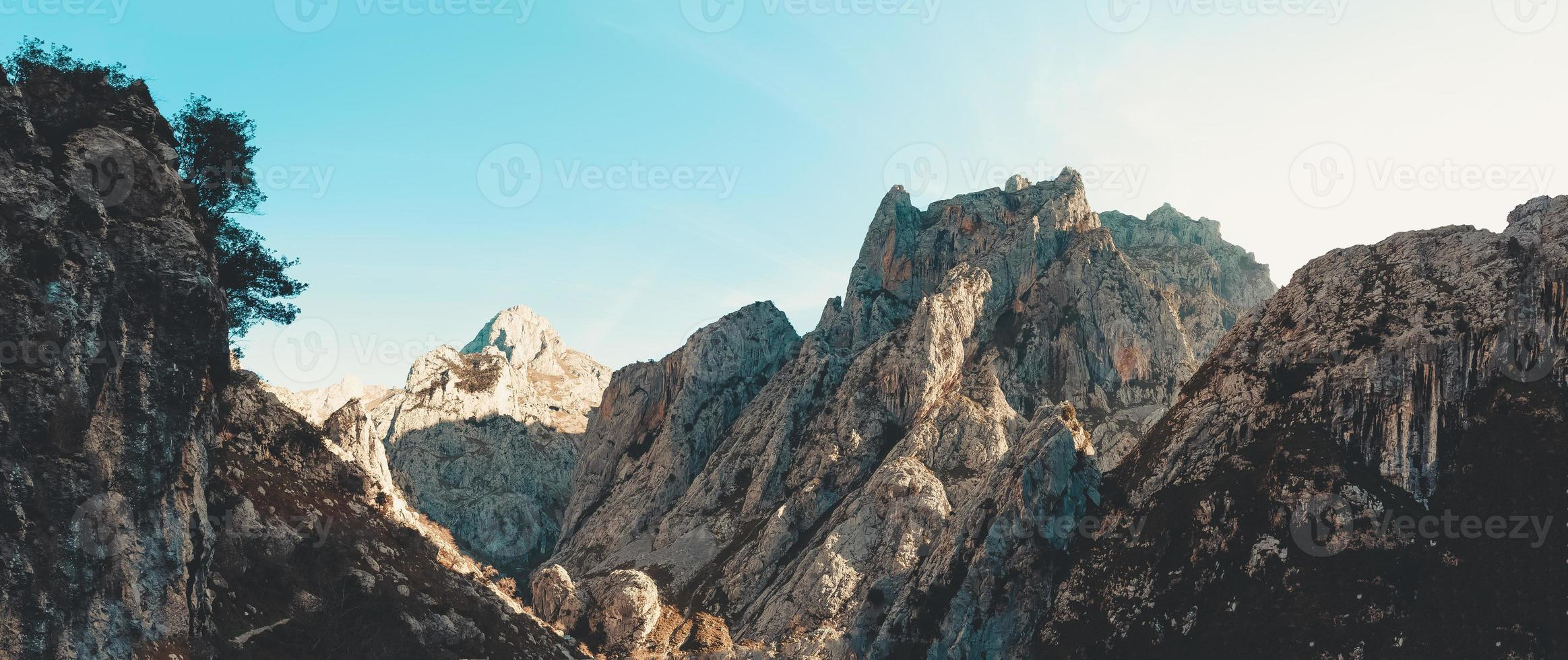 Super panoramic view of a huge rocky mountains photo