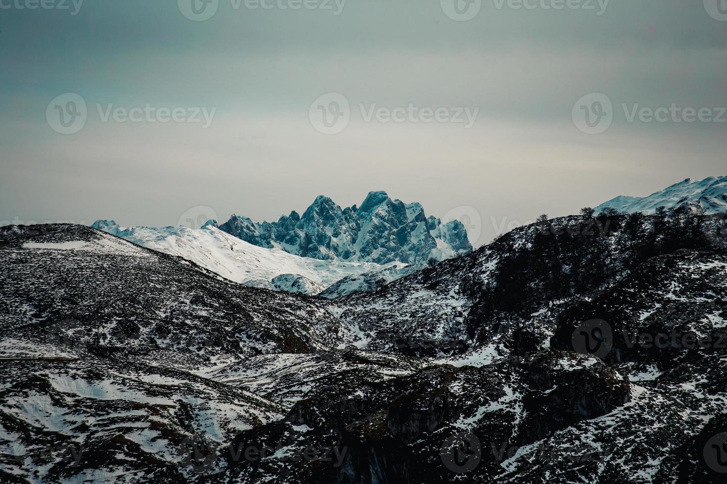 Massive and risky peak in the mountain photo