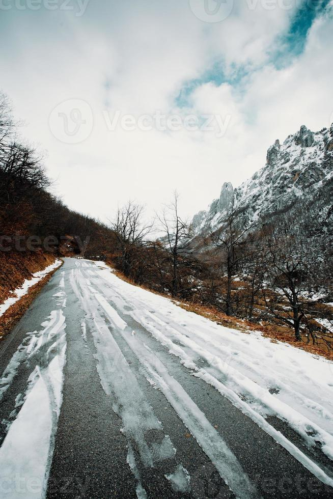 Road on the mountains covered with snow photo