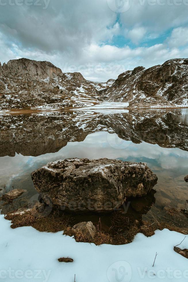 Close up of a rock inside a frozen lake photo