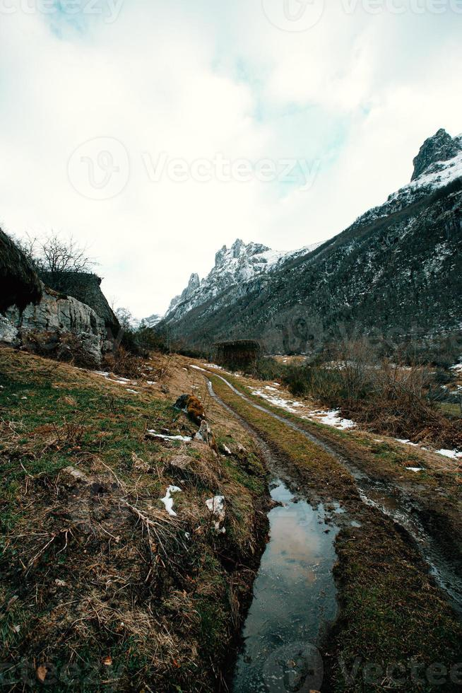 Trekking path in the middle of the mountains photo
