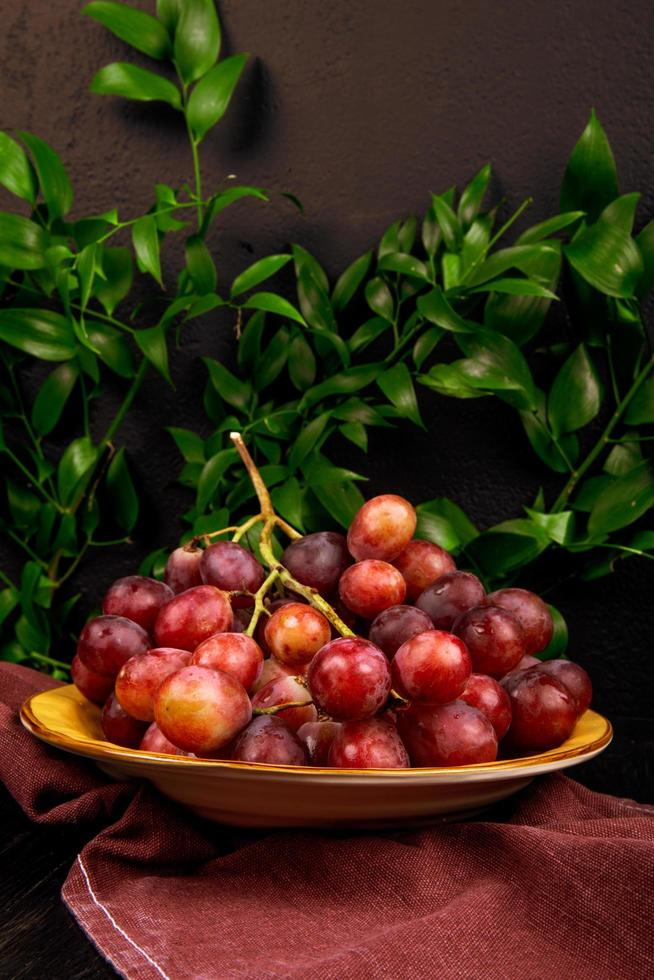 Red grapes on a plate photo