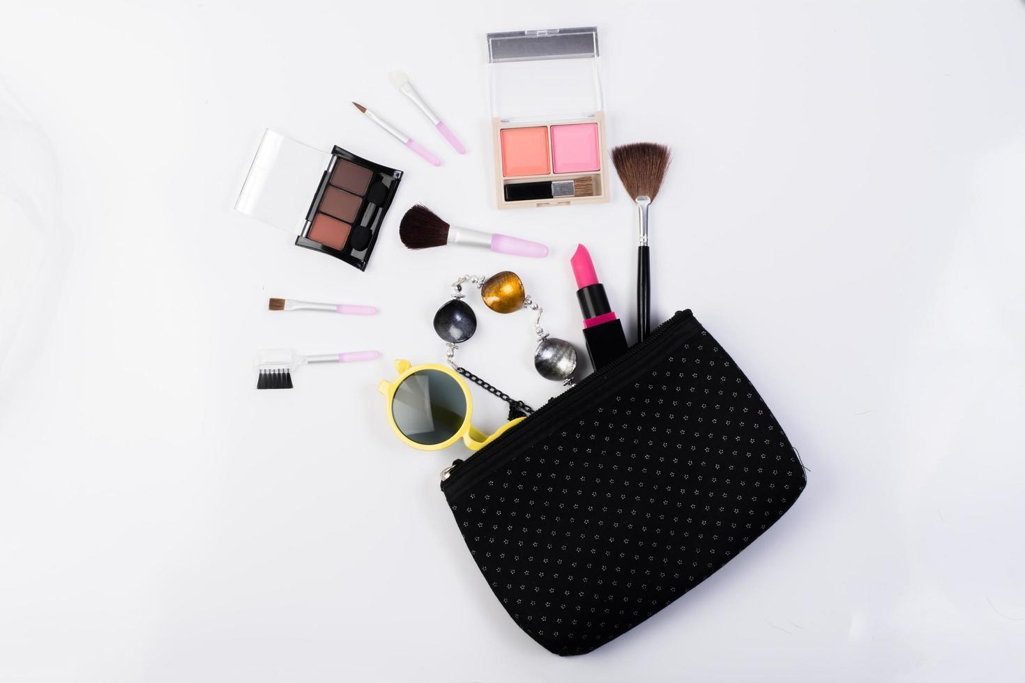 Top view of a make up bag with beauty products photo