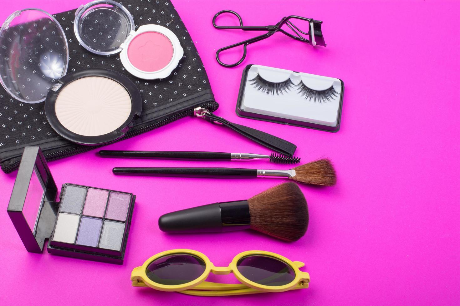 Cosmetic beauty products on pink background photo