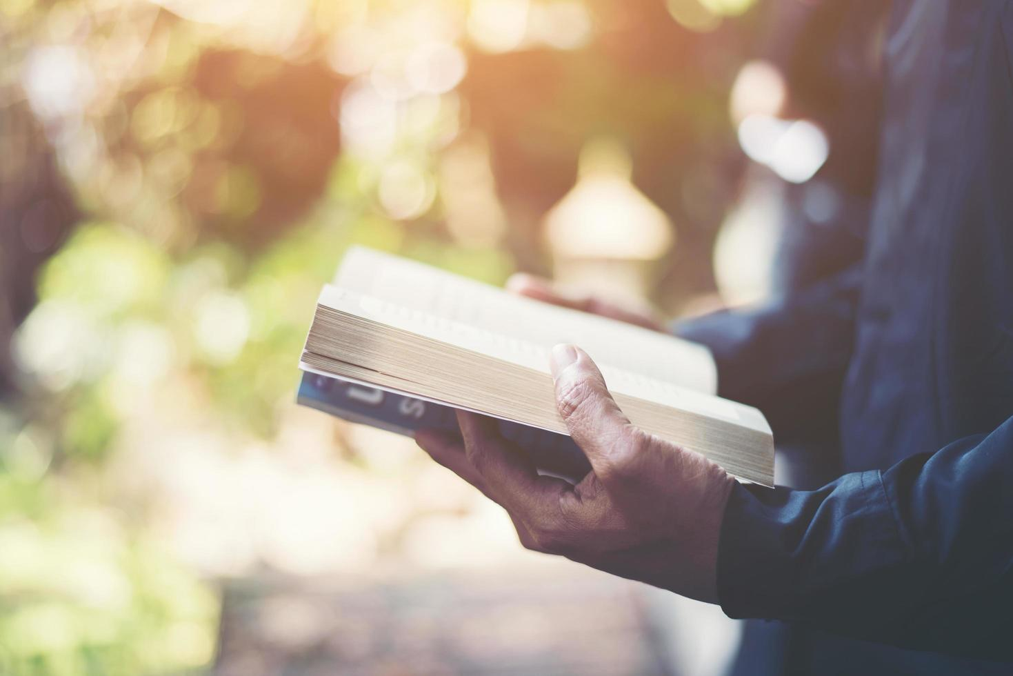 Man reading a book in his hands photo