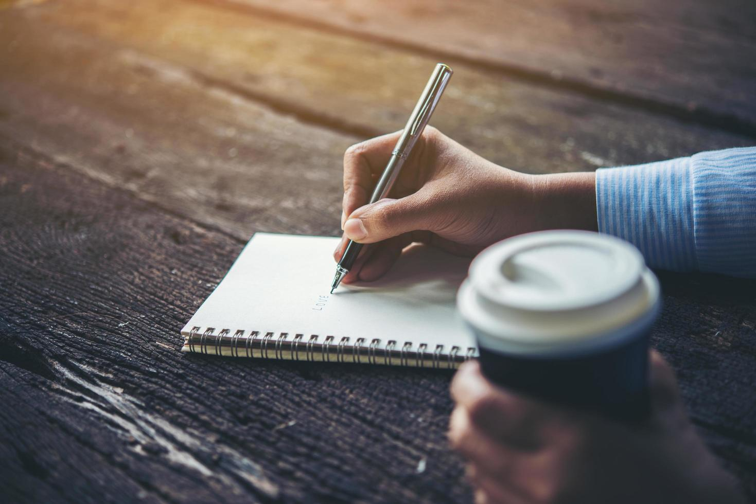 Woman writing in notebook photo