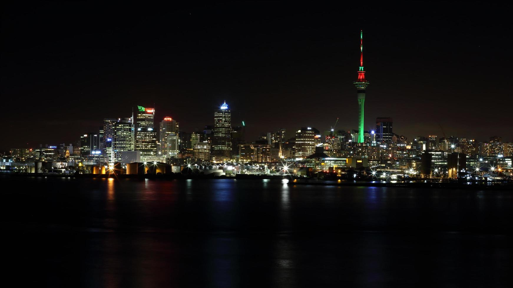 High rise buildings during nighttime photo