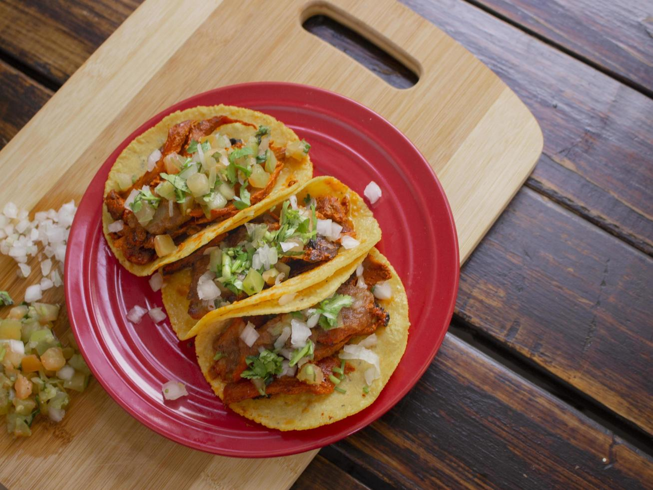 Beef tacos on a red plate photo