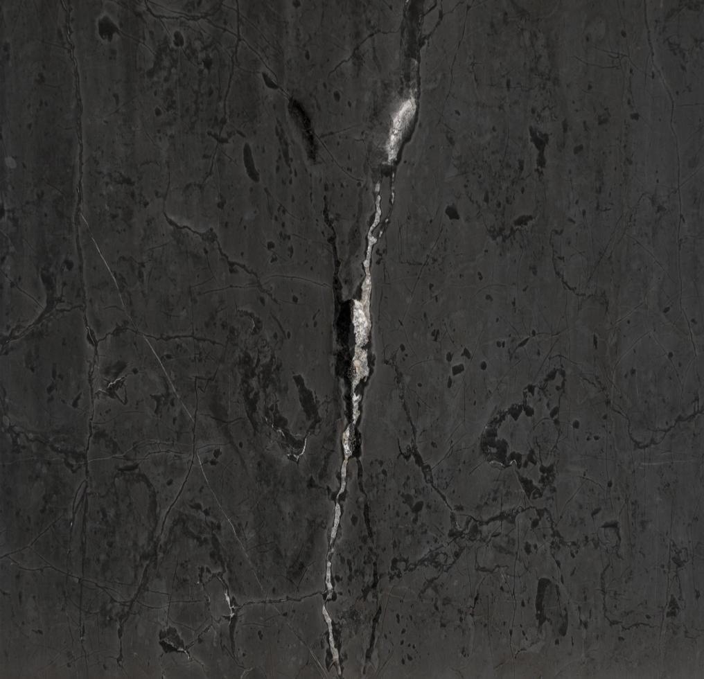 White streak in black stone texture background photo