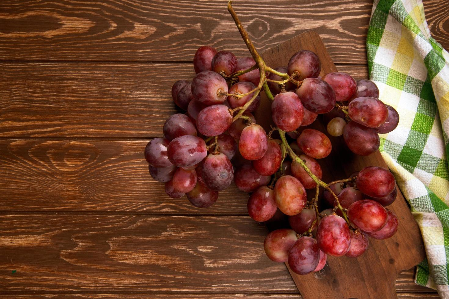 Bunch of fresh grapes on wooden rustic background photo