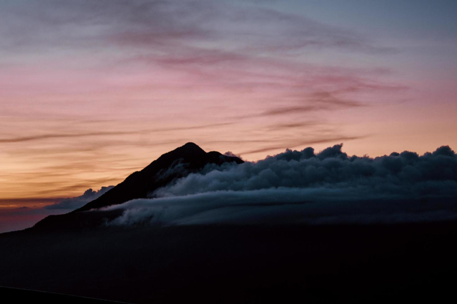 Clouds covering a mountain photo