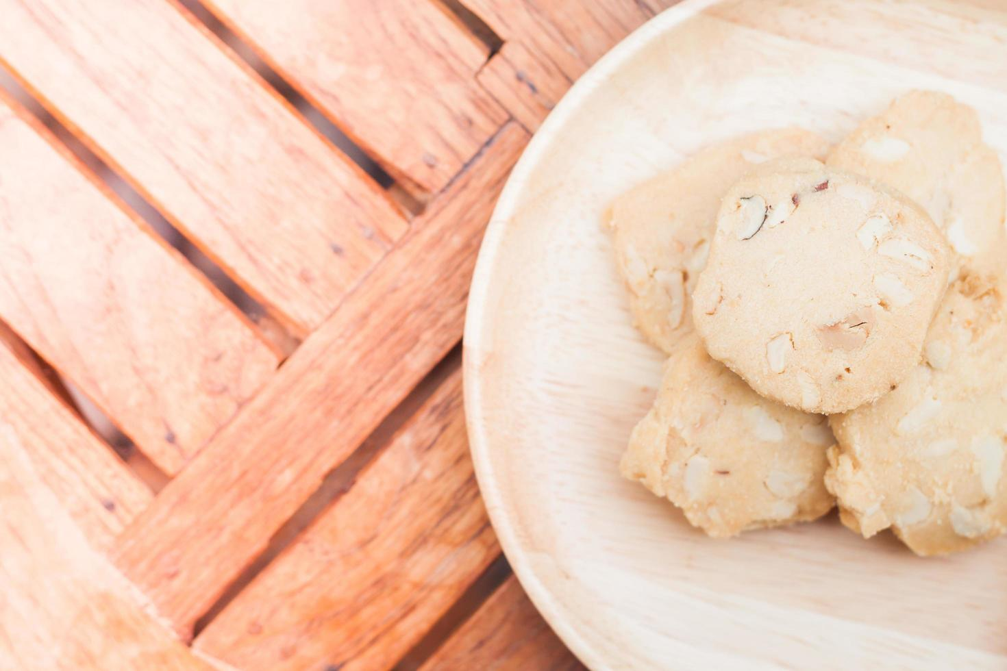 Top view of cashew cookies on a wooden table photo