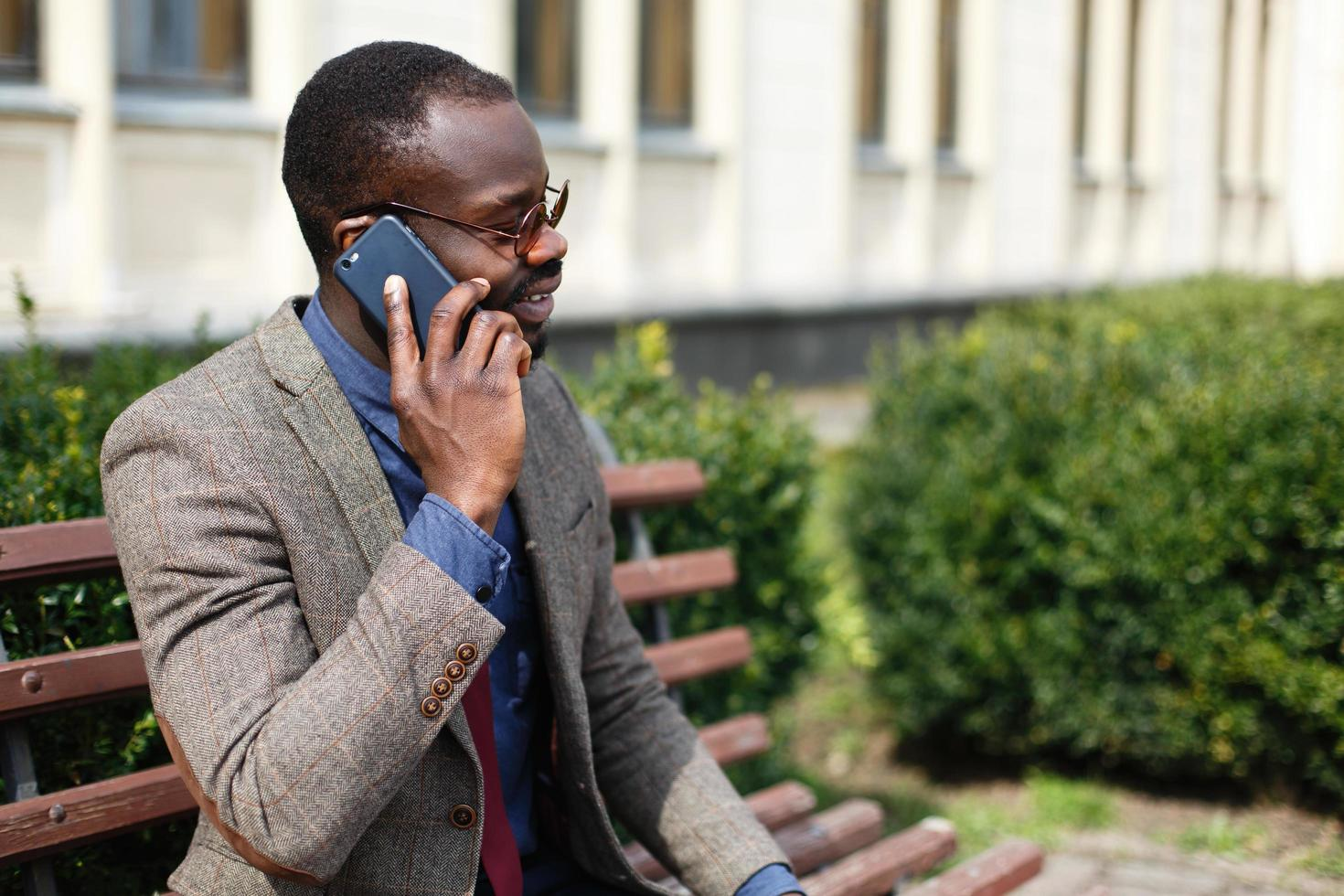 Man talking on the phone outside photo