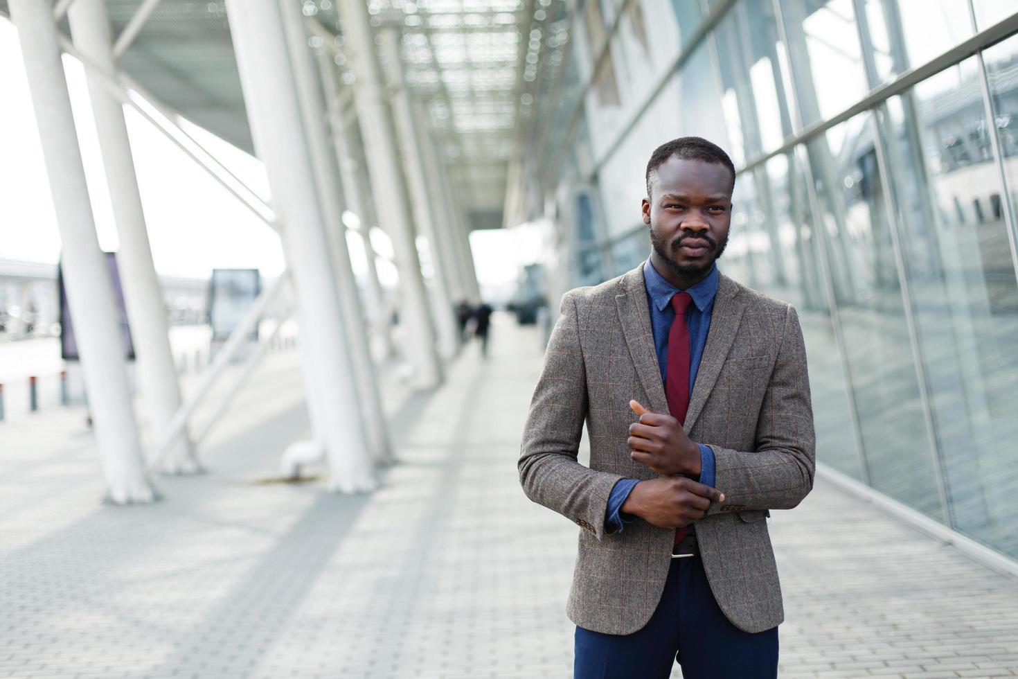 Man in a suit walking photo