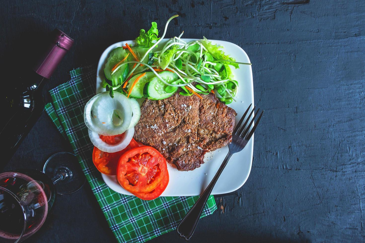 Steak and salad on a plate photo