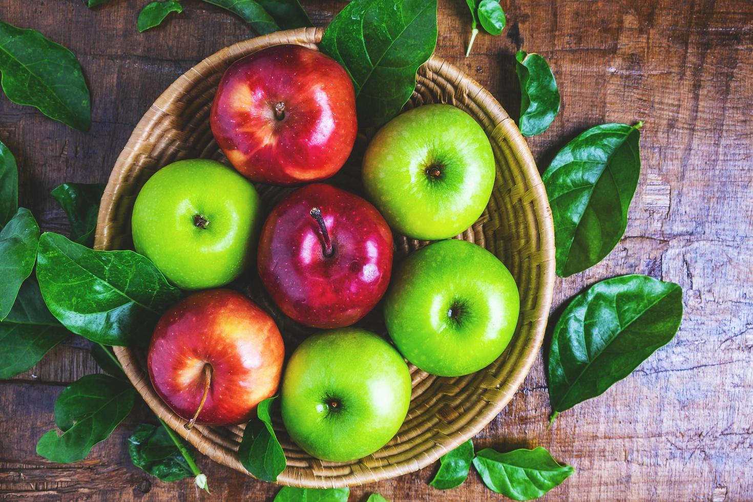 Basket of green and red apples photo