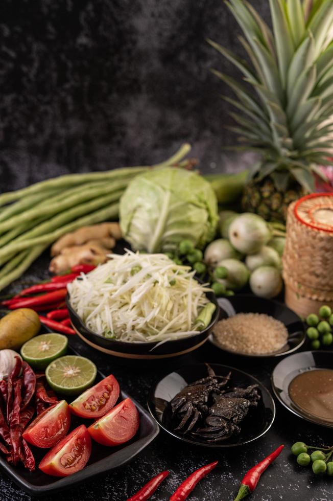 Papaya salad ingredients with fermented fish photo
