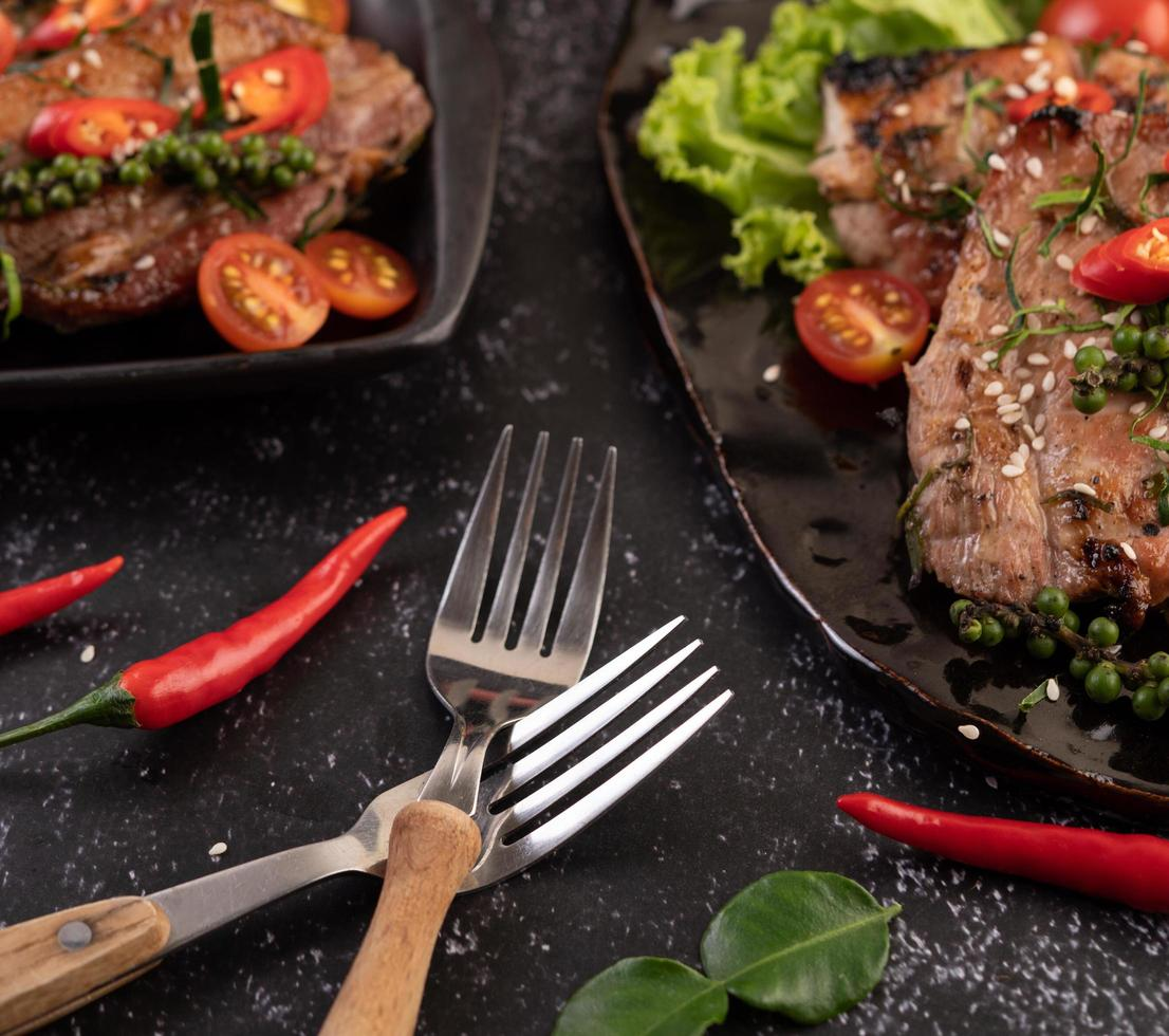 Two forks with chili and kaffir lime leaves photo