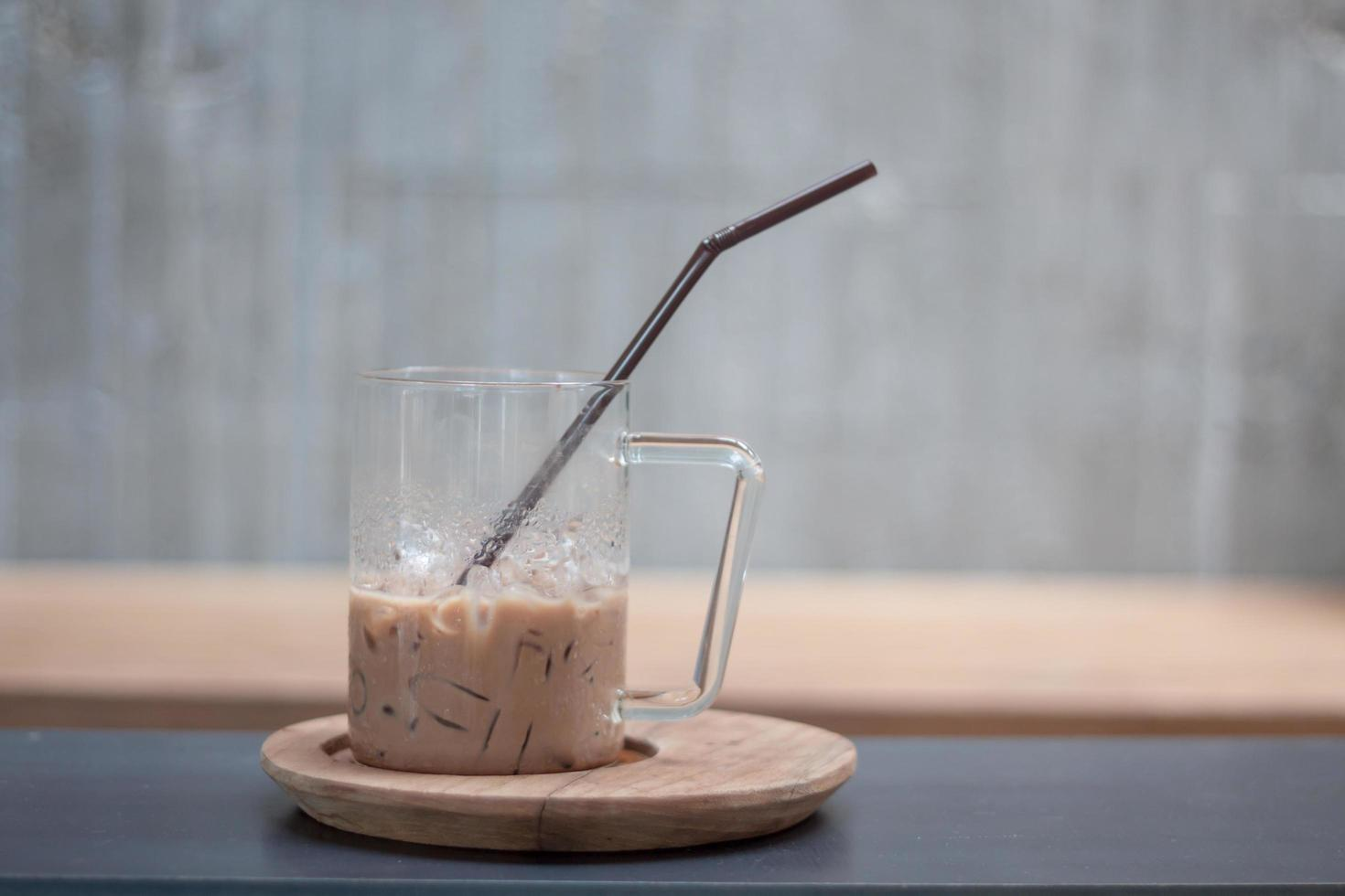 Iced coffee in a glass on a wooden tray photo