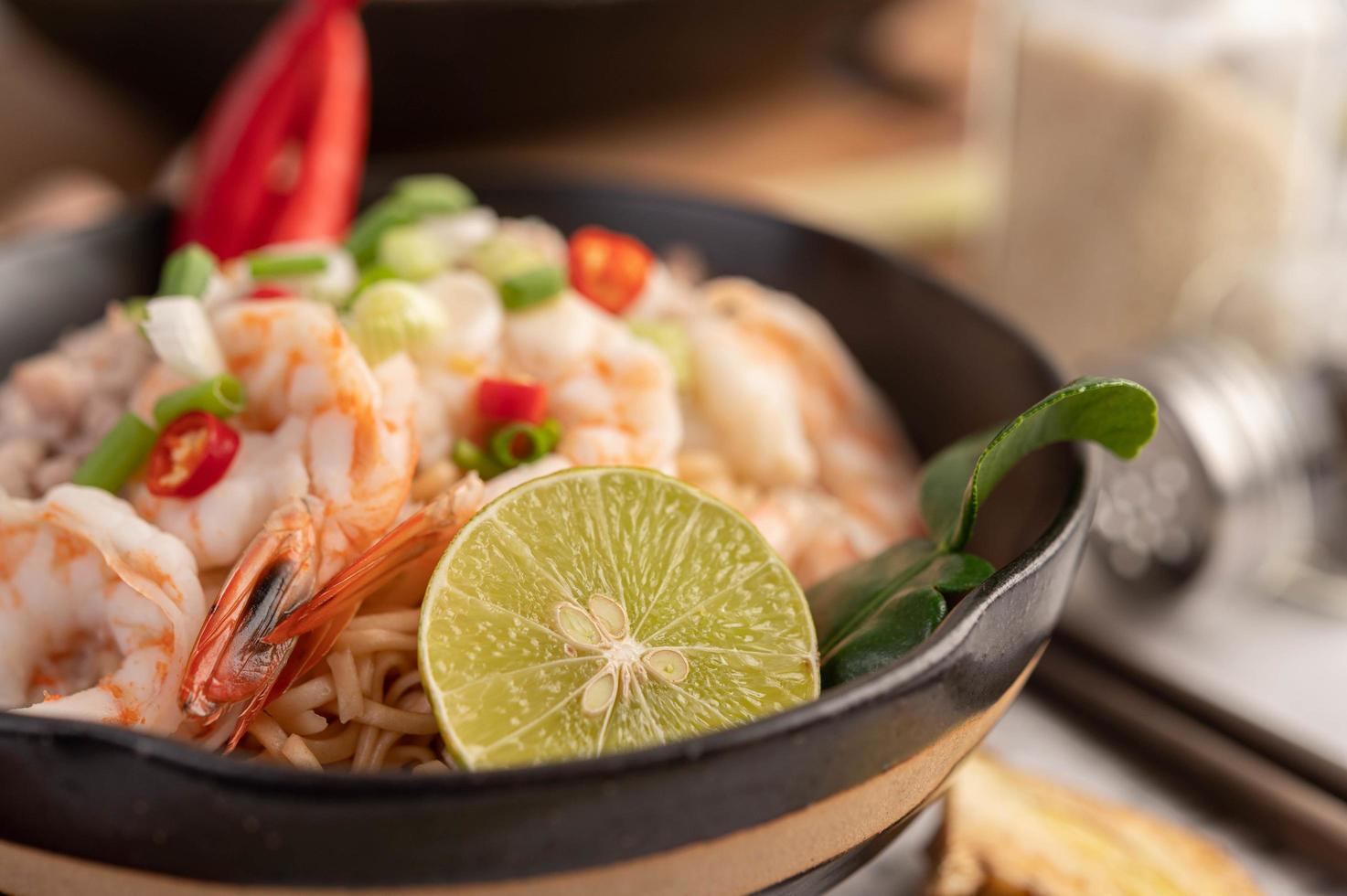 Instant noodles stir-fried with shrimp and pork photo