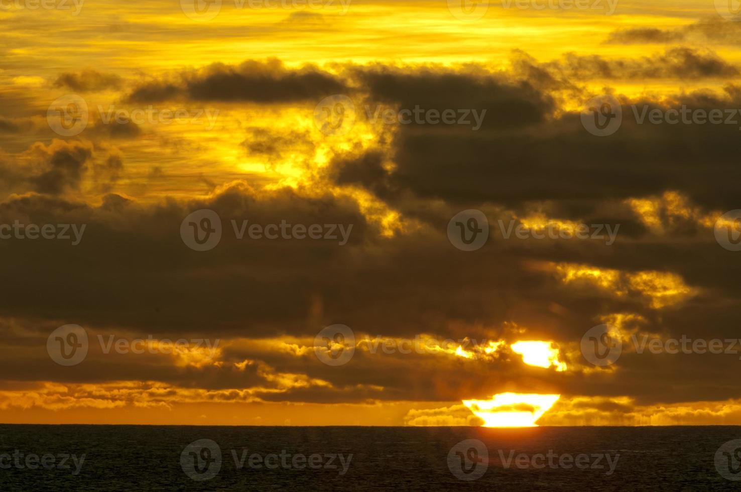 sunset in tropical paradise sand beach photo