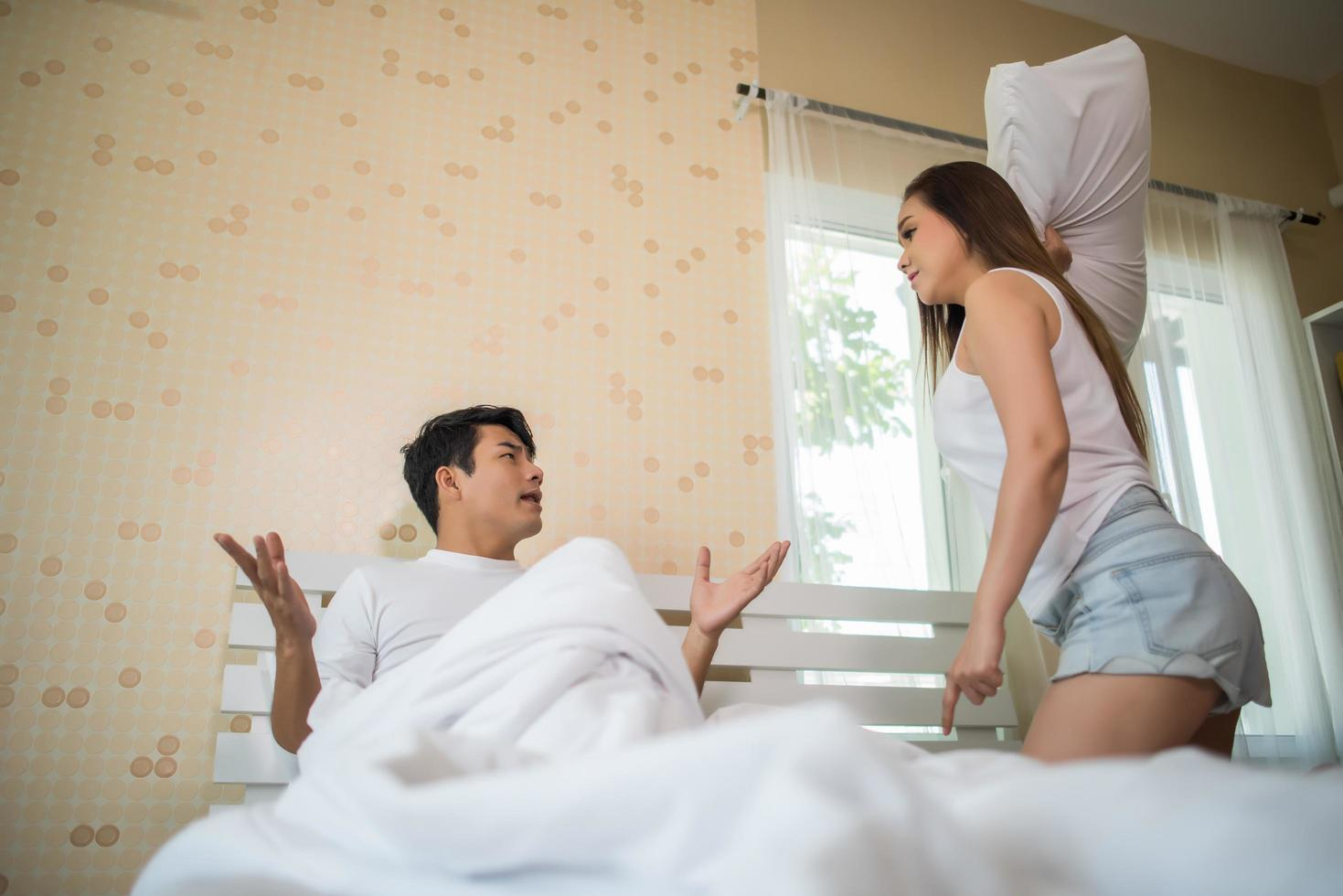 Unhappy couple having an argument in their bedroom photo