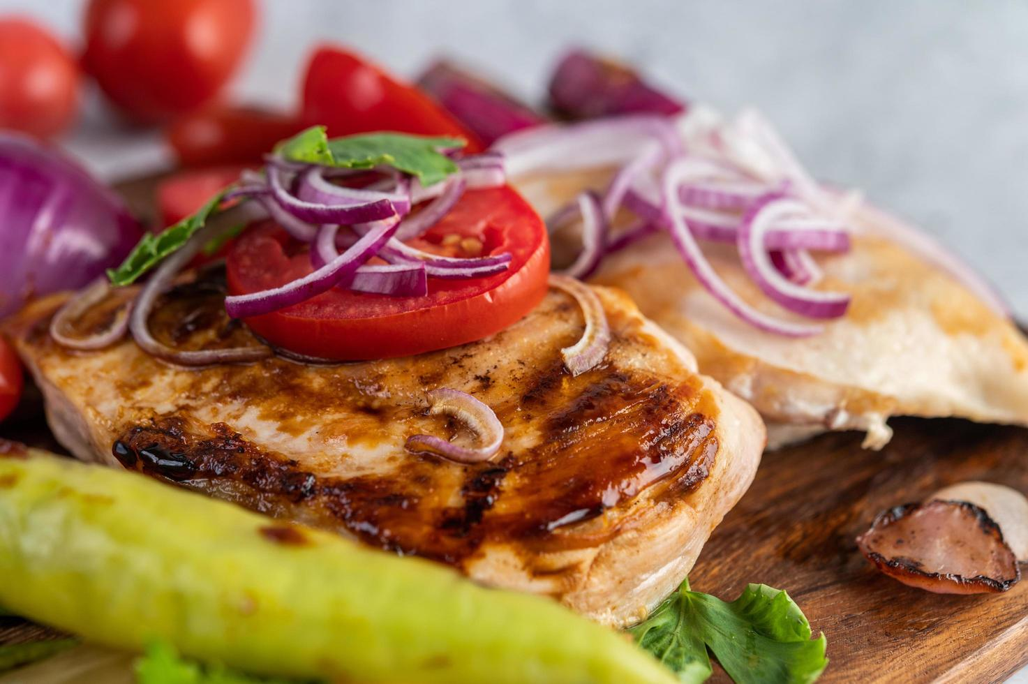 Chicken steak with roasted vegetables photo