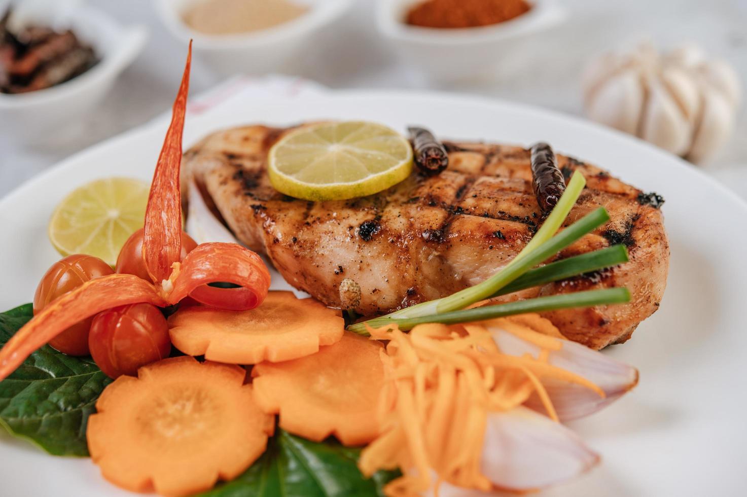 Chicken steak with vegetables photo