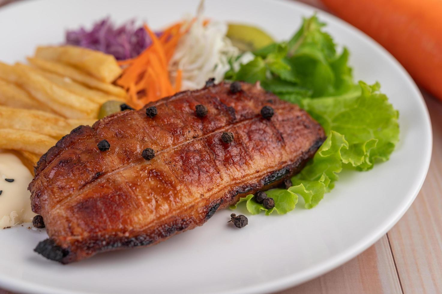 Fish with french fries and salad photo