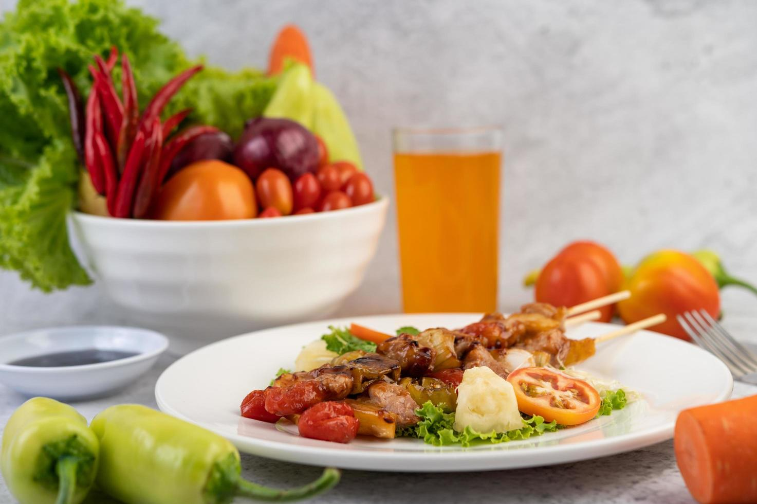 BBQ meat with tomatoes and bell peppers photo