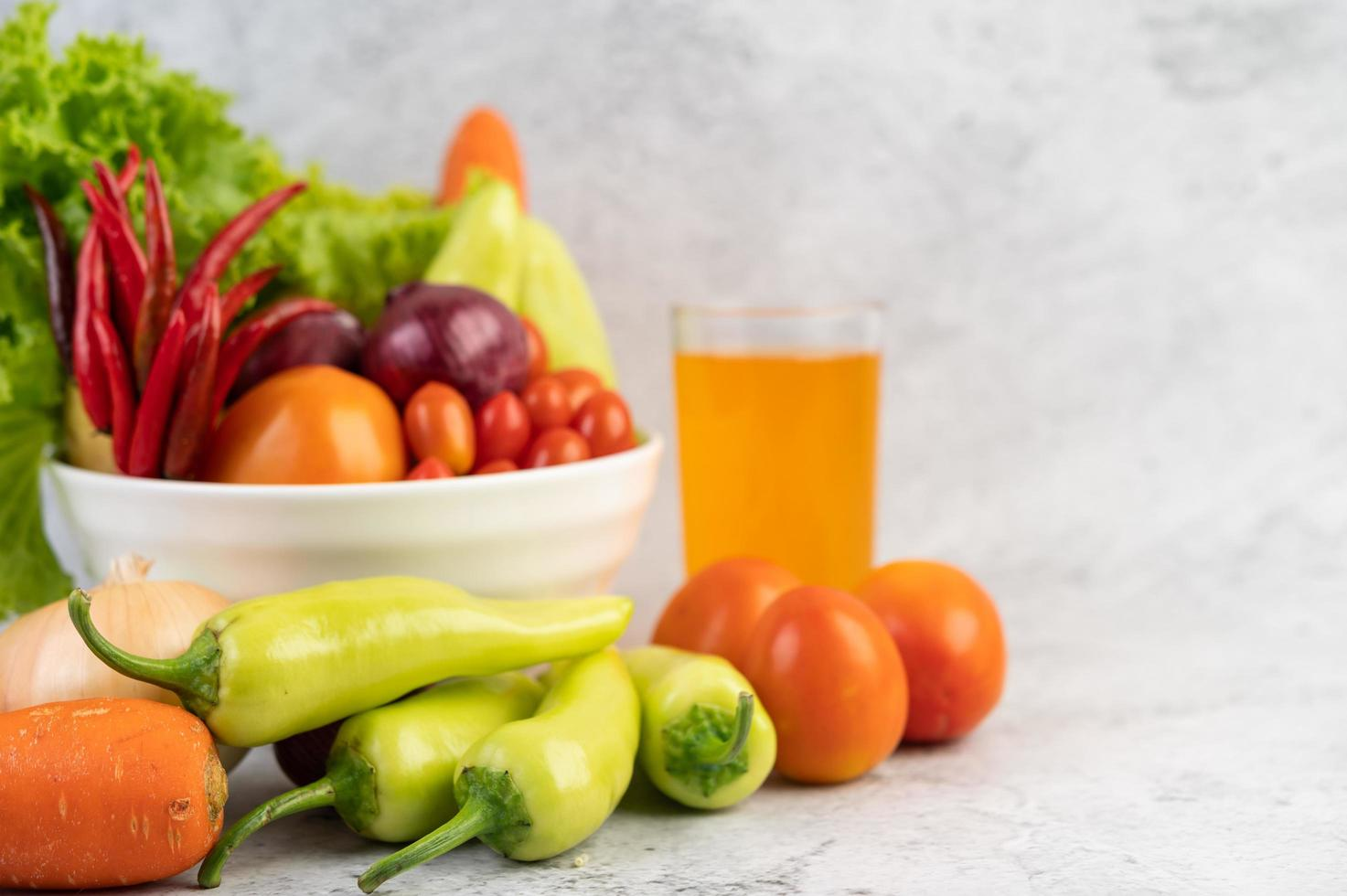 Tomatoes, red onions, bell peppers, carrots and Chinese cabbage photo