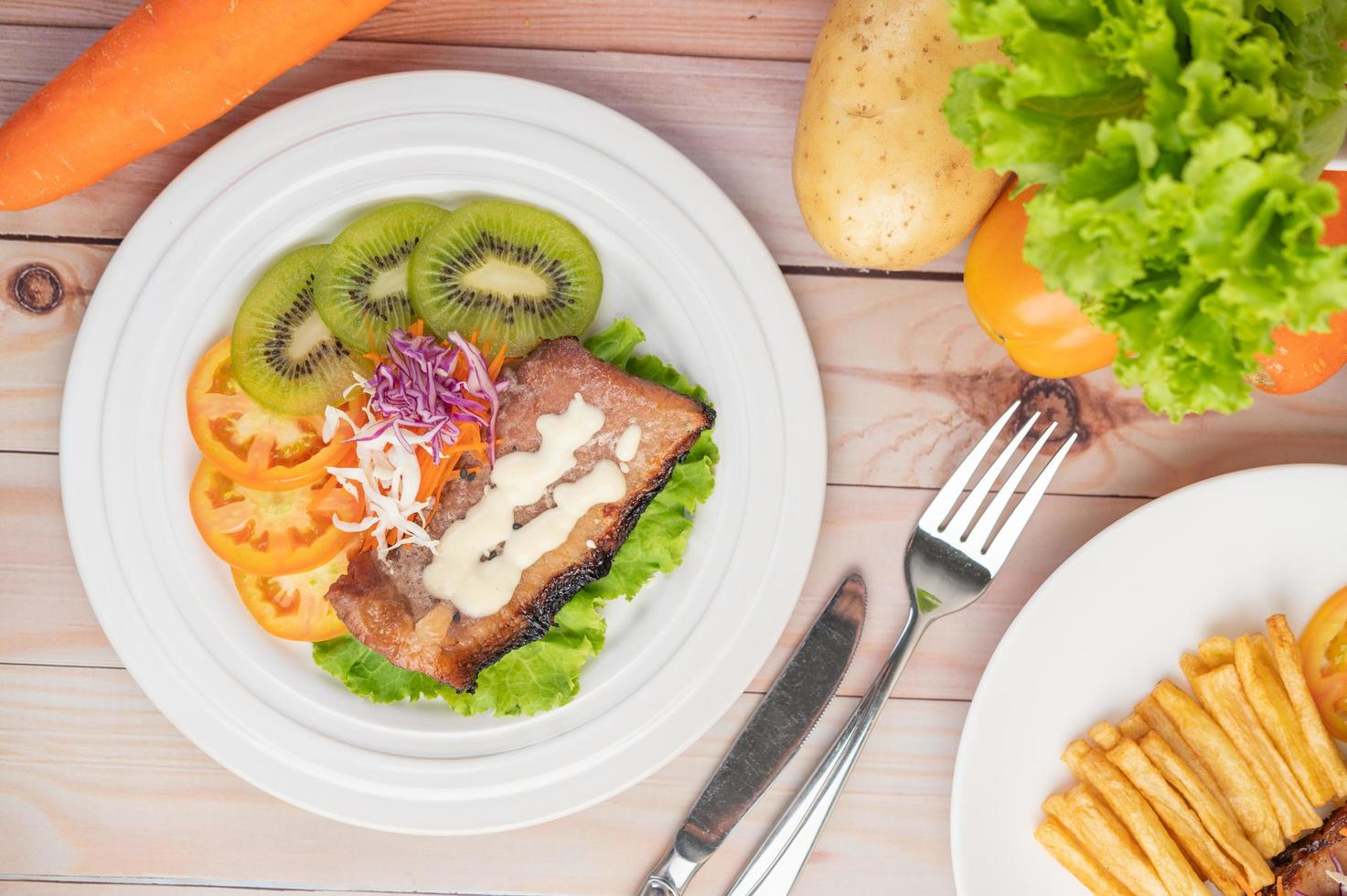 Fish steak with french fries and salad photo
