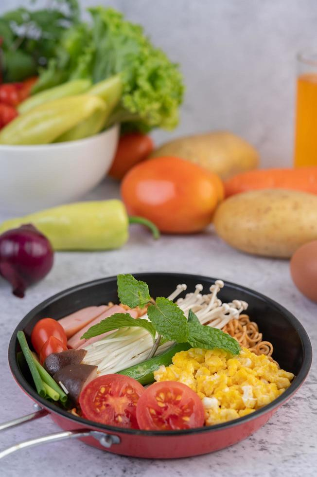 Stir-fried noodles with corn, golden needle mushroom, tomato, sausage and edamame photo