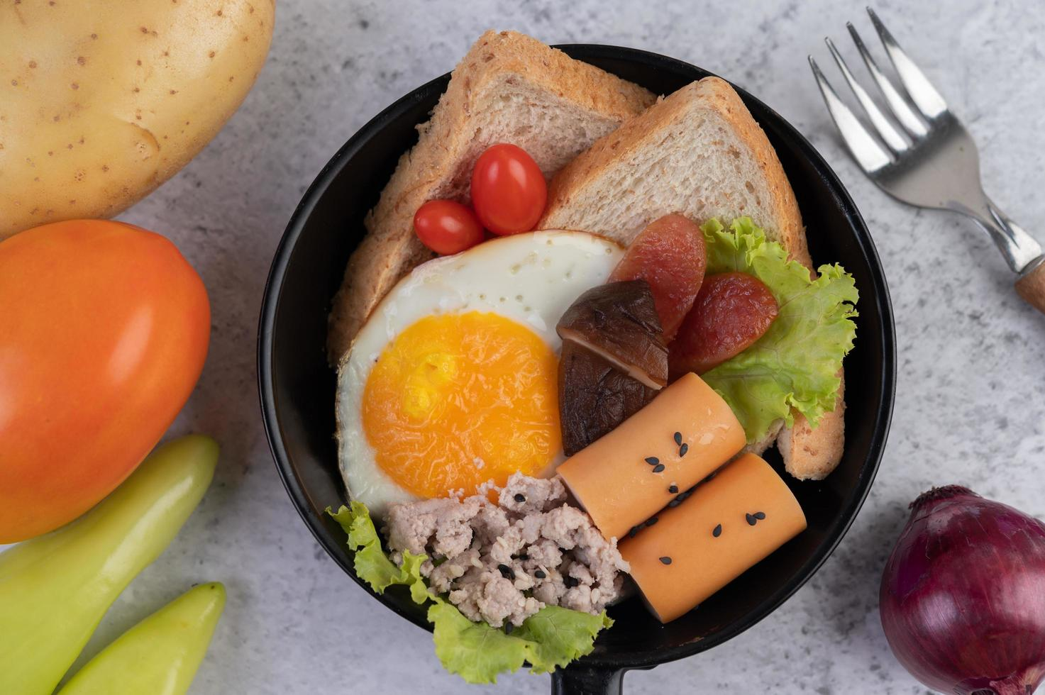 Vegetable salad with bread and boiled eggs photo