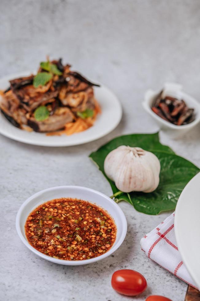 Thai spicy sauce, pork, tomato and garlic photo