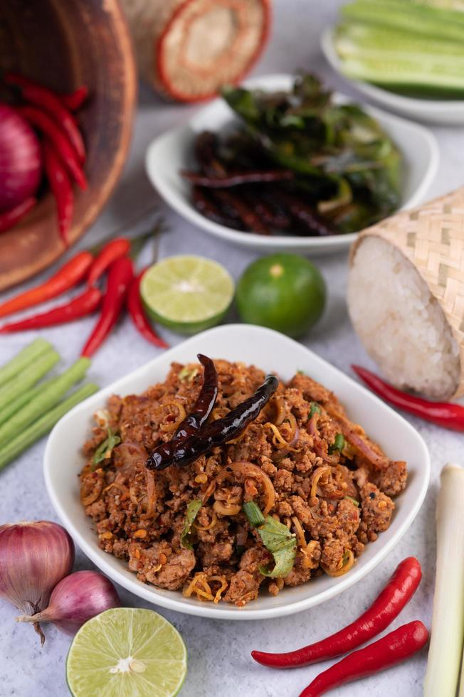 Spicy minced pork in a white bowl photo