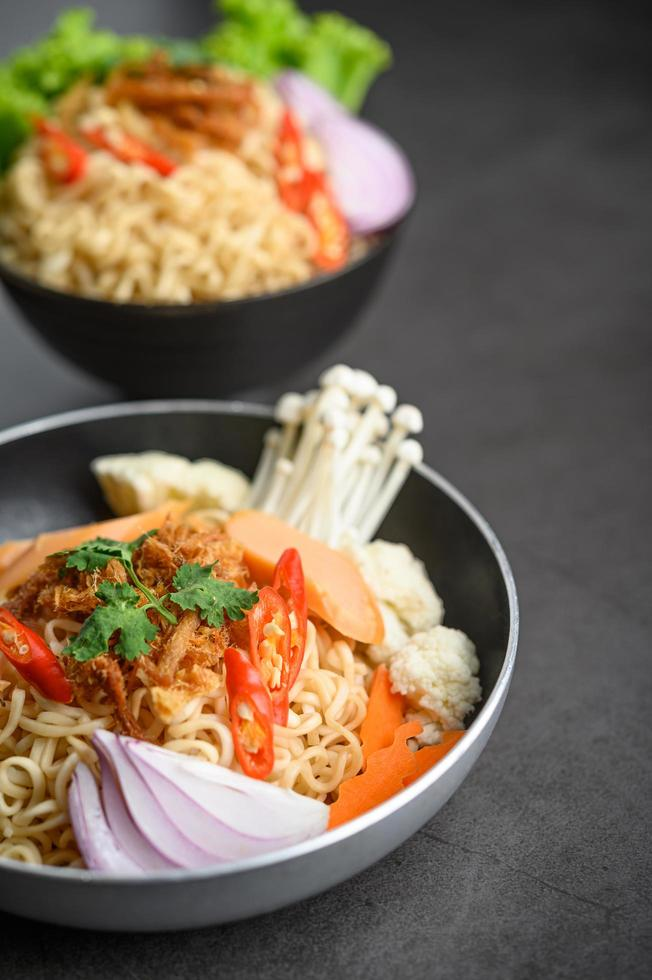 Spicy noodles in a frying pan photo