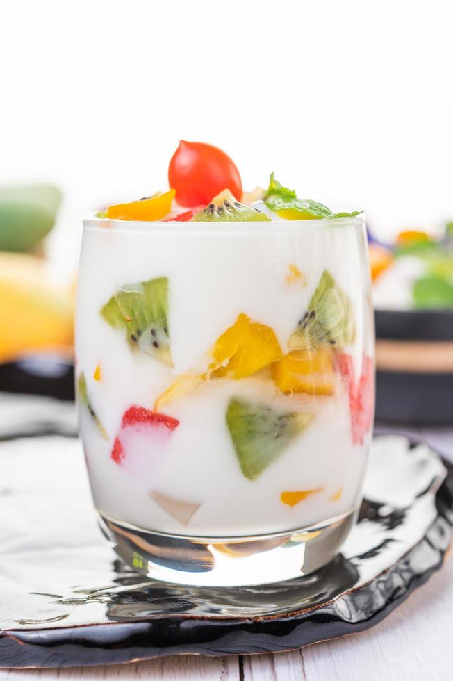 Fruit yogurt smoothie in clear glass photo
