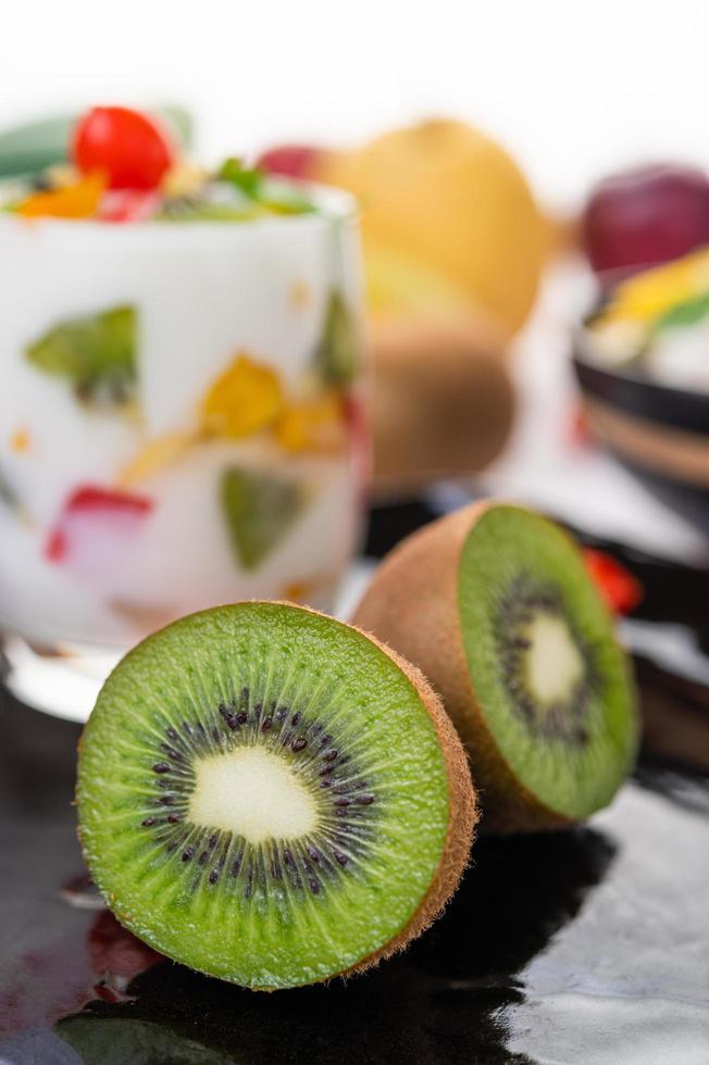 Fruit yogurt smoothie in glass with kiwi up close photo